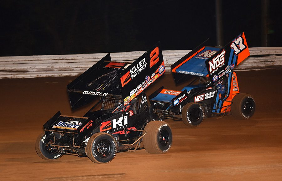 Kerry Madsen (2) leads Sheldon Haudenschild during Friday's World of Outlaws NOS Energy Drink Sprint Car Series National Open preliminary event at Williams Grove Speedway. (Julia Johnson Photo)