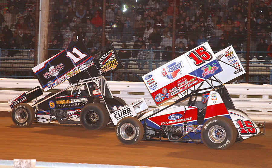 Zeb Wise (11) races ahead of Donny Schatz during Friday's World of Outlaws NOS Energy Drink Sprint Car Series National Open preliminary event at Williams Grove Speedway. (Frank Smith Photo)