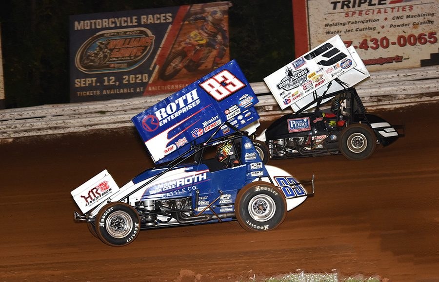 Spencer Bayston (83) battles Jac Haudenschild during Friday's World of Outlaws NOS Energy Drink Sprint Car Series National Open preliminary event at Williams Grove Speedway. (Julia Johnson Photo)