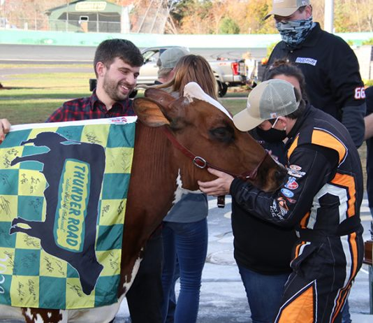 Jason Corliss prepares for a kiss with Miss Vermont Milk Bowl after triumphing in the Vermont Milk Bowl for the third time Sunday at Thunder Road Int'l Speedbowl. (Alan Ward Photo)