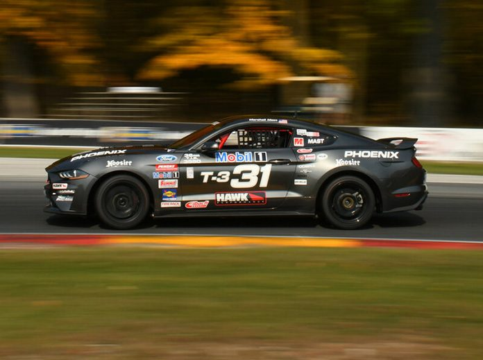 Marshall Mast raced to victory in the Touring 3 portion of the SCCA National Championship Runoffs on Friday at Road America.