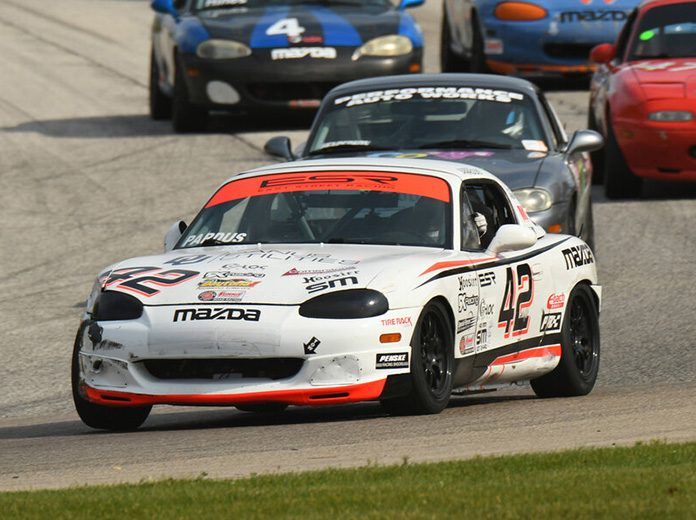 Preston Pardus overcame a 77-car field to win the Spec Miata portion of the SCCA National Championship Runoffs on Friday at Road America.