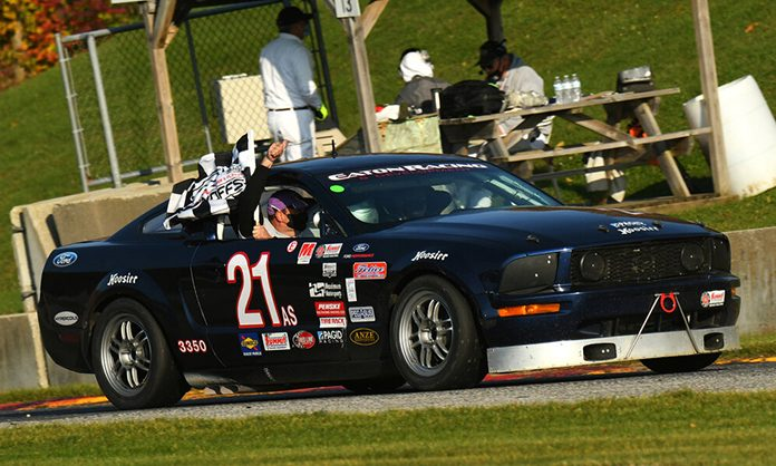 Gregory Eaton celebrates his win in the American Sedan division Saturday during the SCCA National Championship Runoffs.