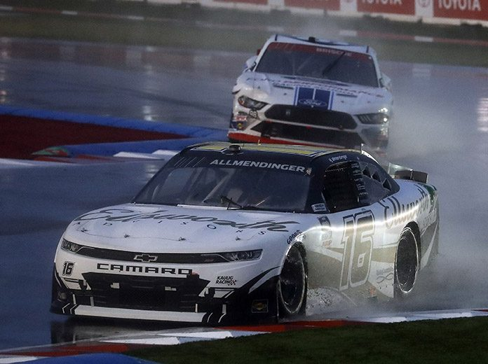 A.J. Allmendinger (16) races ahead of Chase Briscoe in the rain Saturday on the Charlotte Motor Speedway ROVAL. (HHP/Andrew Coppley Photo)