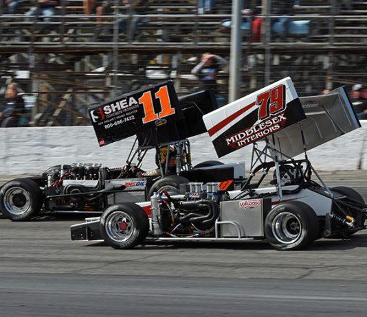 Jon McKennedy (79) races alongside Chris Perley Sunday at Thompson Speedway Motorsports Park. (Jim Feeney Photo)