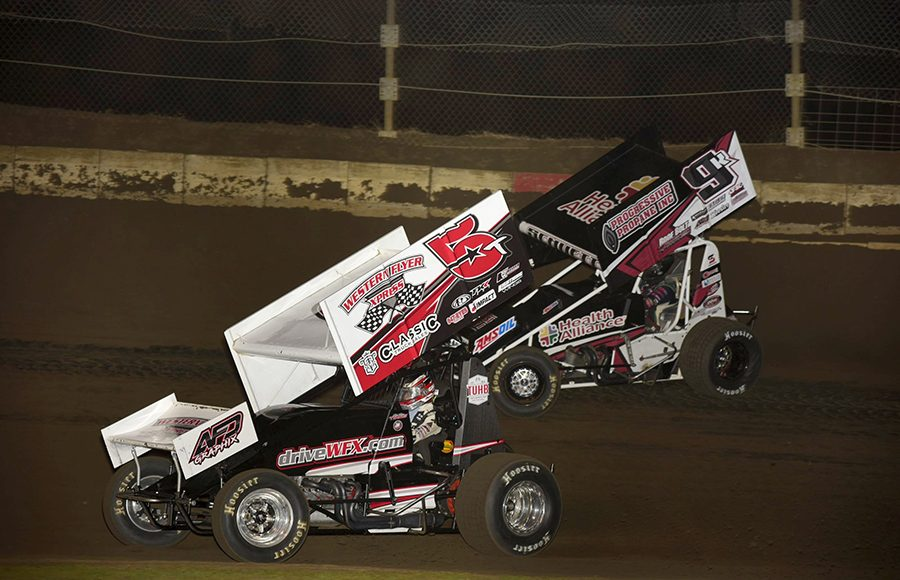 Ryam Timms (5) races under Kyle Schuett during Friday's Built Ford Tough MOWA Sprint Car Series event at Jacksonville Speedway. (Mark Funderburk Photo)