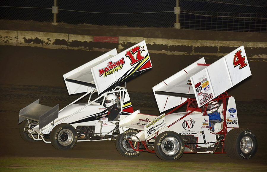 Danny Smith (4) chases Rob Standridge during Friday's Built Ford Tough MOWA Sprint Car Series event at Jacksonville Speedway. (Mark Funderburk Photo)