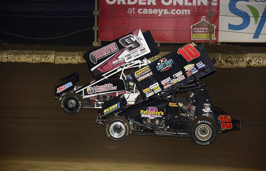Morgan Turpen (10) battles Kyle Schuett during Friday's Built Ford Tough MOWA Sprint Car Series event at Jacksonville Speedway. (Mark Funderburk Photo)