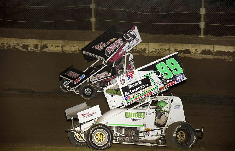 Korey Weyant (99) races alongside Kyle Schuett during Friday's Built Ford Tough MOWA Sprint Car Series event at Jacksonville Speedway. (Mark Funderburk Photo)
