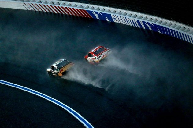Stephen Leicht (13) races under Michael Annett in the rain during Saturday's Drive for the Cure 250 on the Charlotte Motor Speedway ROVAL. (Sean Gardner/Getty Images Photo)