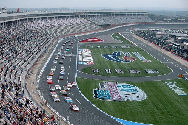The field races into turn one at the start of Saturday's NASCAR Xfinity Series Drive for the Cure 250 on the Charlotte Motor Speedway ROVAL. (Sean Gardner/Getty Images Photo)