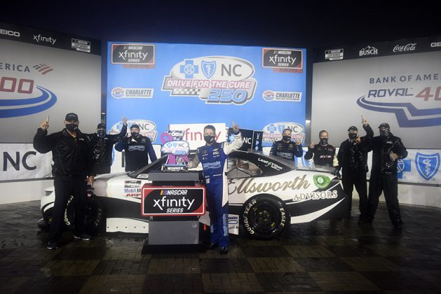 A.J. Allmendinger shares victory lane with his crew after winning Saturday's Drive for the Cure 250 on the Charlotte Motor Speedway ROVAL. (Jared C. Tilton/Getty Images Photo)