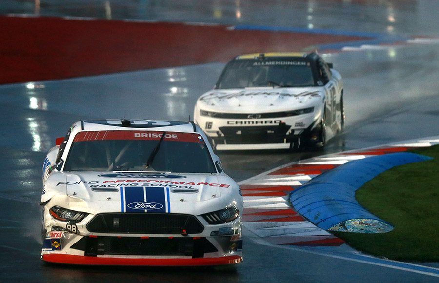 Chase Briscoe (98) battles A.J. Allmendinger for the race lead during Saturday's Drive for the Cure 250 on the Charlotte Motor Speedway ROVAL. (Sean Gardner/Getty Images Photo)