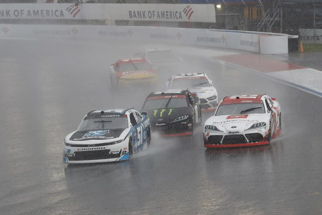 Jeremy Clements (51) and Brandon Jones (19) lead a group of cars in the rain during the Drive for the Cure 250 Saturday on the Charlotte Motor Speedway ROVAL. (HHP/Harold Hinson Photo)