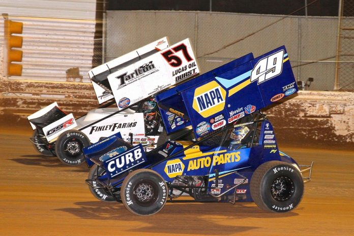 Kyle Larson (57) battles past Brad Sweet during Saturday's World of Outlaws Nittany Showdown finale at Port Royal Speedway. (Dan Demarco photo)