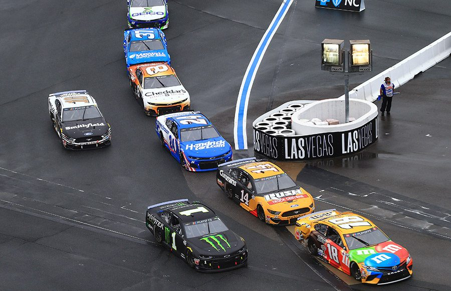 Kyle Busch (18) leads a pack of cars out of the infield and onto the oval portion of the ROVAL Sunday at Charlotte Motor Speedway. (HHP/Jim Fluharty Photo)