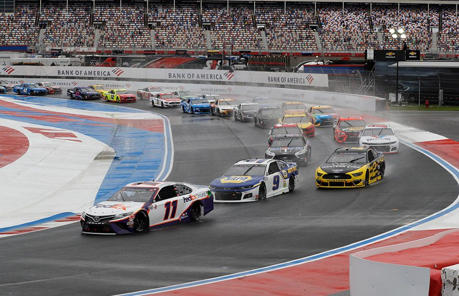 Denny Hamlin (11) leads the pack on the soggy infield section of the Charlotte Motor Speedway ROVAL Sunday afternoon. (HHP/Harold Hinson Photo)