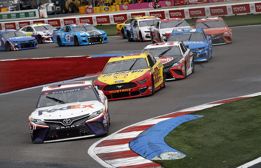 Denny Hamlin (11) leads a pack of cars during Sunday's Bank of America ROVAL 400 at Charlotte Motor Speedway. (HHP/Andrew Coppley Photo)