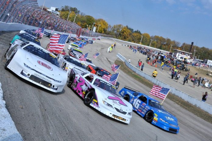The three-wide parade lap prior to Sunday's 49th Winchester 400 at Winchester (Ind.) Speedway. (Randy Crist photo)