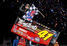 Shane Stewart enjoys victory lane at Lakeside Speedway. (TWC photo)