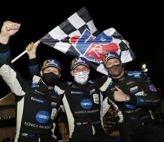 Wayne Taylor Racing teammates Scott Dixon, Renger van der Zande and Ryan Briscoe celebrate winning Saturday's Petit Le Mans. (IMSA photo)