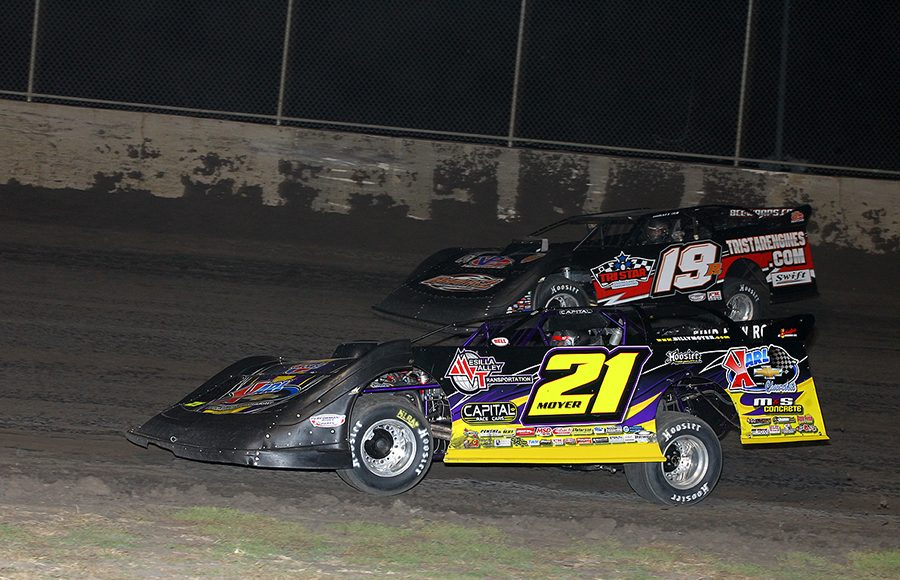 Billy Moyer (21) battles Ryan Gustin during Friday's Lucas Oil MLRA event at Tri-City Speedway. (Mike Ruefer Photo)