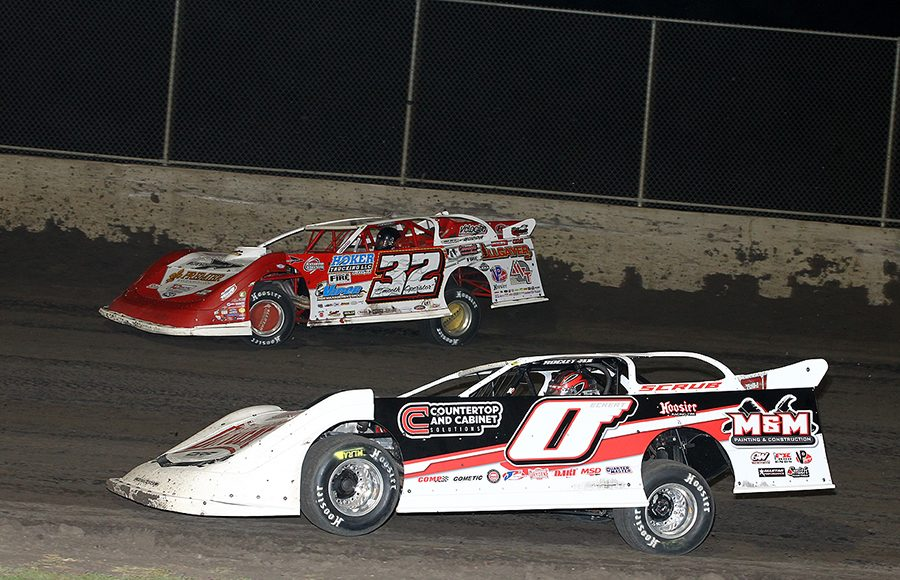 Rick Eckert (0) battles Bobby Pierce during Friday's Lucas Oil MLRA event at Tri-City Speedway. (Mike Ruefer Photo)
