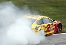Joey Logano celebrates with a burnout after winning Sunday's Hollywood Casino 400. (HHP/Andrew Coppley Photo)