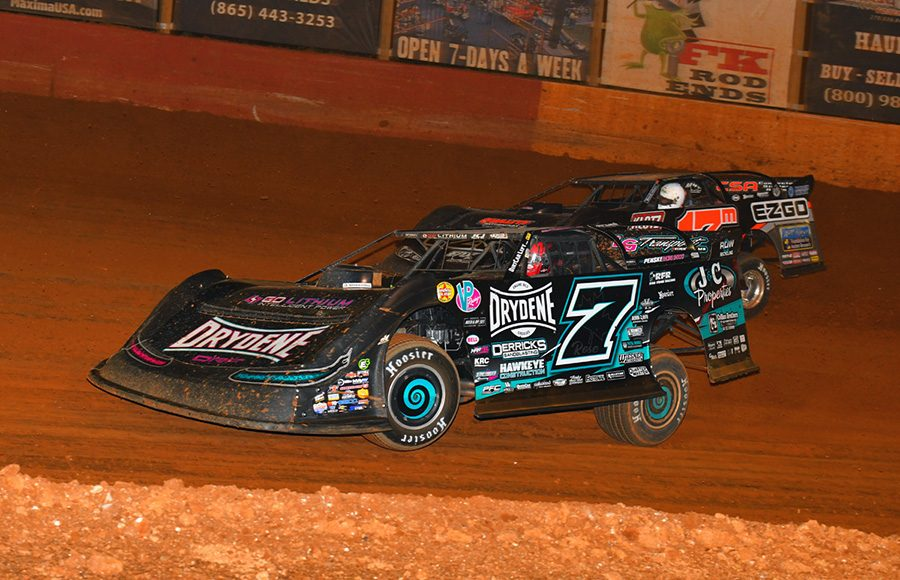 Ricky Weiss (7) races under Dale McDowell during Friday's Southern All Star Series event at Smoky Mountain Speedway. (Michael Moats Photo)