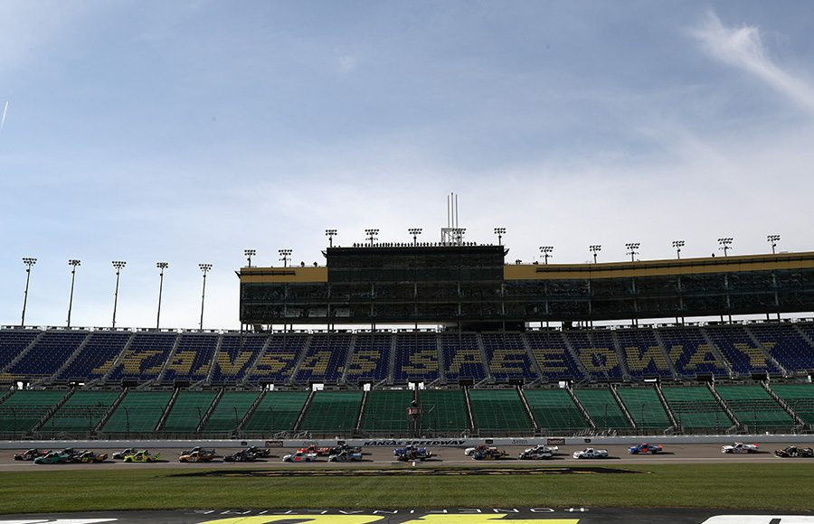 Drivers in the NASCAR Gander RV & Outdoors Truck Series battle for position Saturday at Kansas Speedway. (Chris Graythen/Getty Images Photo)