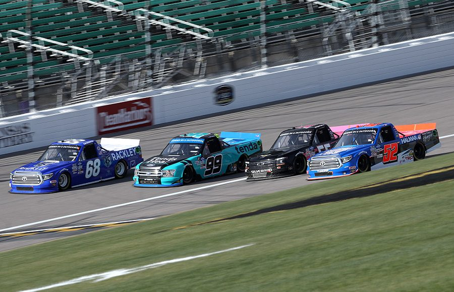 Clay Greenfield (68), Ben Rhodes (99), Tyler Hill (56) and Timothy Peters (52) race four-wide during Saturday's NASCAR Gander RV & Outdoors Truck Series race at Kansas Speedway. (Chris Graythen/Getty Images Photo)