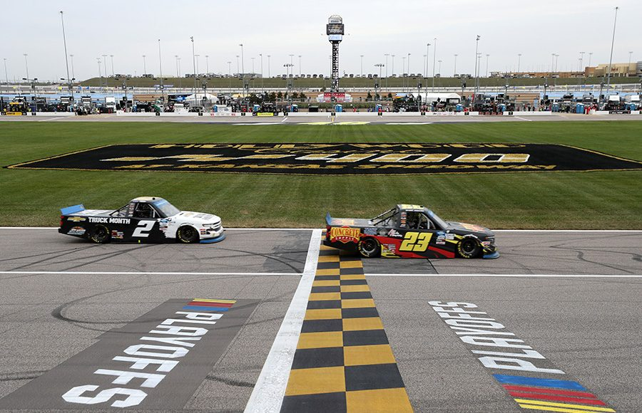 Brett Moffitt (23) beats Sheldon Creed to the finish line to win Saturday's NASCAR Gander RV & Outdoors Truck Series race at Kansas Speedway. (Jamie Squire/Getty Images Photo)