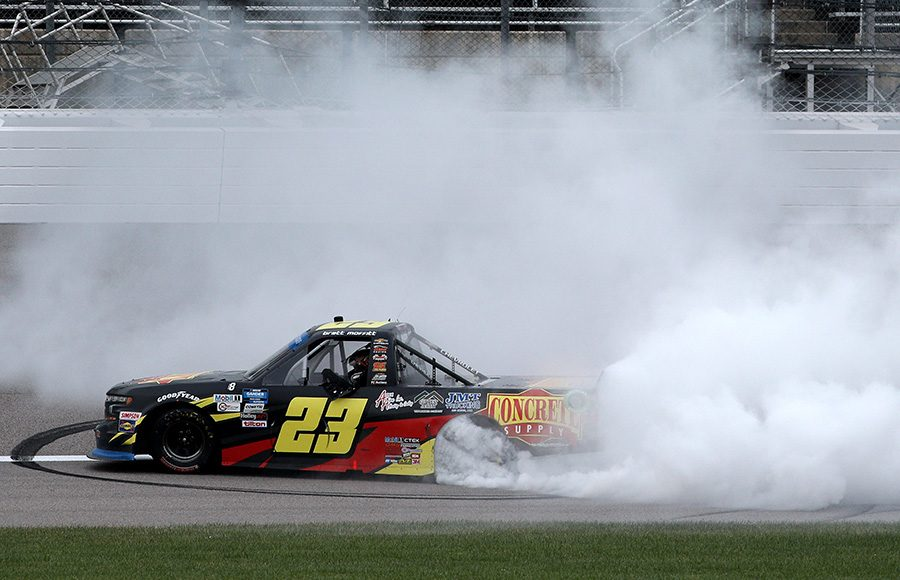 Brett Moffitt celebrates with a burnout after winning Saturday's NASCAR Gander RV & Outdoors Truck Series event at Kansas Speedway. (Chris Graythen/Getty Images Photo)