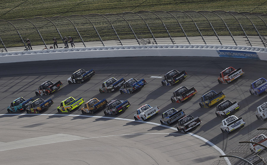 Drivers battle through turns one and two during Saturday's NASCAR Gander RV & Outdoors Truck Series race at Kansas Speedway. (HHP/Andrew Coppley Photo)