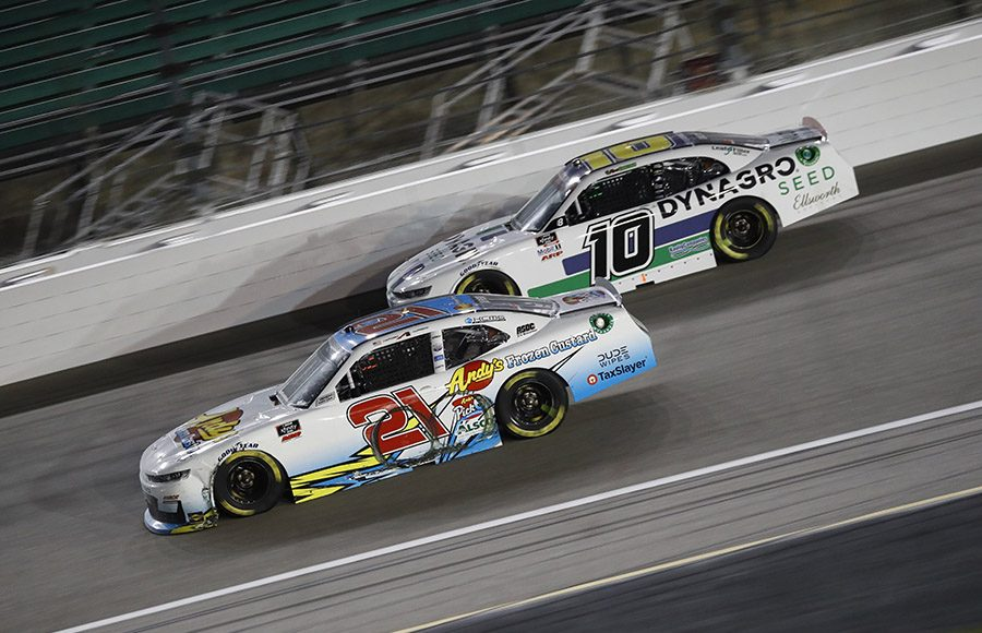 Anthony Alfredo (21) races under Ross Chastain during Saturday's NASCAR Xfinity Series event at Kansas Speedway. (HHP/Harold Hinson Photo)