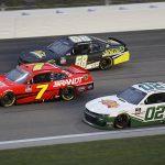 Brett Moffitt (02), Justin Allgaier (7) and Brandon Brown race three-wide during Saturday's NASCAR Xfinity Series event at Kansas Speedway. (HHP/Harold Hinson Photo)