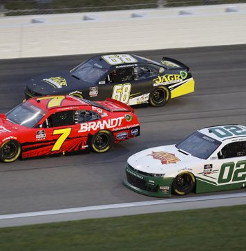 Brett Moffitt (02), Justin Allgaier (7) and Brandon Brown race three-wide during Saturday's NASCAR Xfinity Series event at Kansas Speedway. (HHP/Harold Hinson Photo)