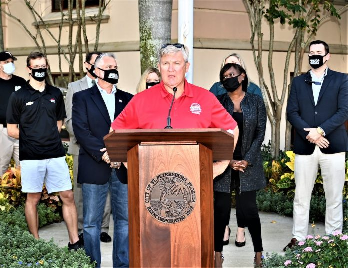 Kevin Savoree, promoter of the Firestone Grand Prix of St. Petersburg (center), and other officials gather for the announcement of Firestone's sponsorship extension of the event through 2023. (Al Steinberg photo)