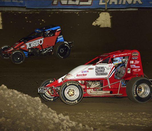 Tyler Courtney (7) races around the outside of Clinton Boyles Saturday at Kokomo Speedway. (Mark Funderburk Photo)