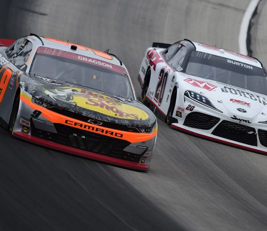 Noah Gragson (9) battles Harrison Burton for the race lead during Saturday's NASCAR Xfinity Series event at Texas Motor Speedway. (Jared C. Tilton/Getty Images Photo)