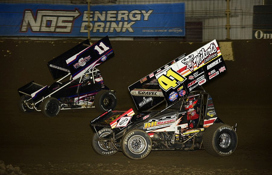 David Gravel (41) races under Ian Madsen during Saturday's World of Outlaws NOS Energy Drink Sprint Car Series event at Kokomo Speedway. (Mark Funderburk Photo)