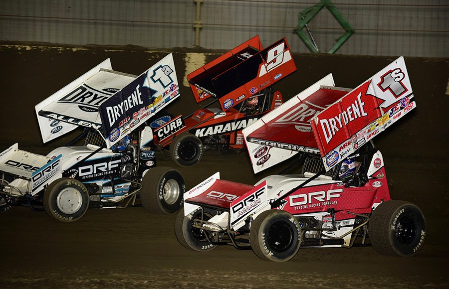 Logan Schuchart (1s), Jacob Allen (1a) and James McFadden battle for position during Saturday's World of Outlaws NOS Energy Drink Sprint Car Series event at Kokomo Speedway. (Mark Funderburk Photo)