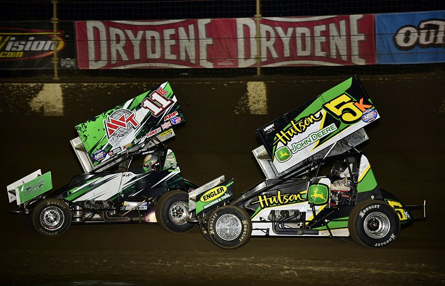 Kraig Kinser (11k) leads Paul Nienhiser during Saturday's World of Outlaws NOS Energy Drink Sprint Car Series event at Kokomo Speedway. (Mark Funderburk Photo)