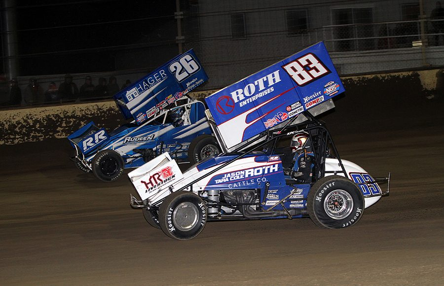 Dominic Scelzi (83) battles under Cory Eliason during Saturday's World of Outlaws NOS Energy Drink Sprint Car Series event at Kokomo Speedway. (Jim Denhamer Photo)
