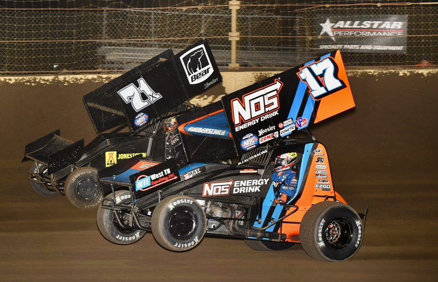 Sheldon Haudenschild (17) races under Spencer Bayston during Saturday's World of Outlaws NOS Energy Drink Sprint Car Series event at Kokomo Speedway. (David Nearpass Photo)