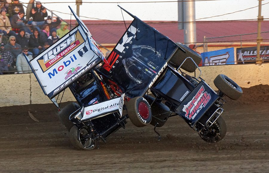 Tim Kaeding and Kerry Madsen colide during Saturday's World of Outlaws NOS Energy Drink Sprint Car Series event at Kokomo Speedway. (Gary Gasper Photo)