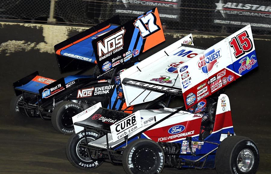 Donny Schatz (15) races alongside Sheldon Haudenschild during Saturday's World of Outlaws NOS Energy Drink Sprint Car Series event at Kokomo Speedway. (Frank Smith Photo)