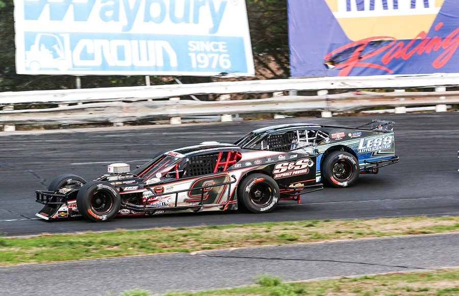 Chase Dowling (9) races alongside Ronnie Williams during Saturday's Tri Track Open Modified Series race at Stafford Motor Speedway. (Dick Ayers Photo)