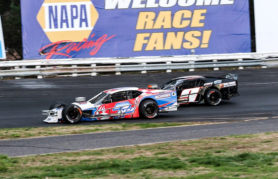 Mike Christopher Jr. (7) battles Tommy Barrett Jr. during Saturday's Tri Track Open Modified Series race at Stafford Motor Speedway. (Dick Ayers Photo)