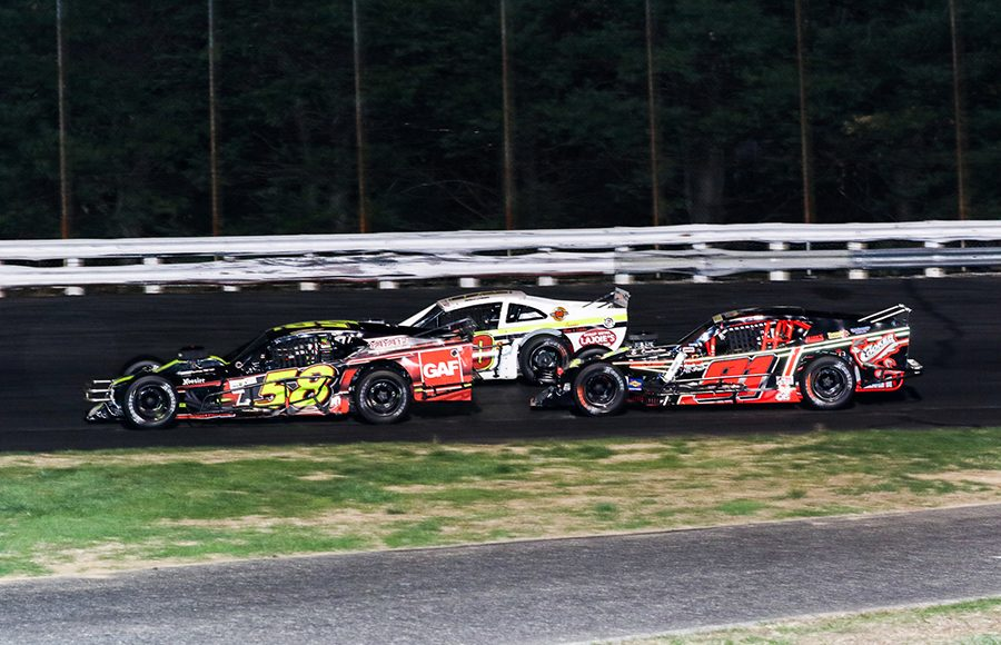 Eric Goodale (58), Ron Silk (81) and Todd Owen battle for position during Saturday's Tri Track Open Modified Series race at Stafford Motor Speedway. (Dick Ayers Photo)